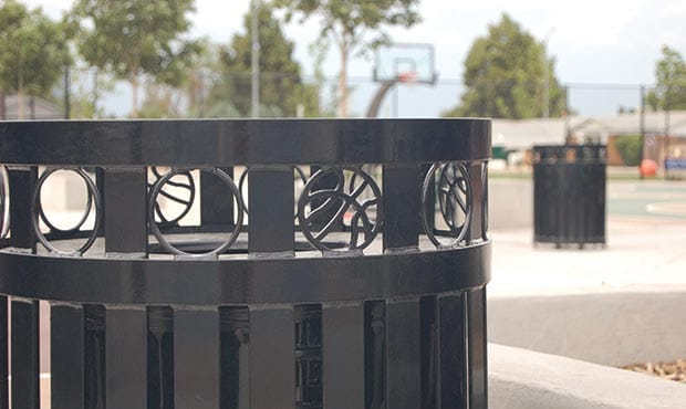 Atlanta litter receptacle with basketball themed laser cuts