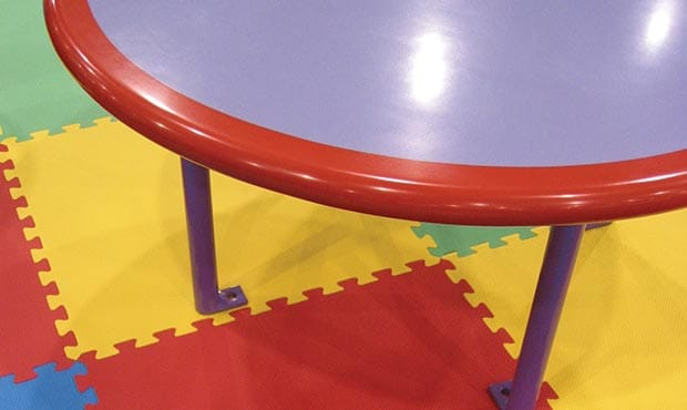 Children's Gathering table with bright colored floor mats