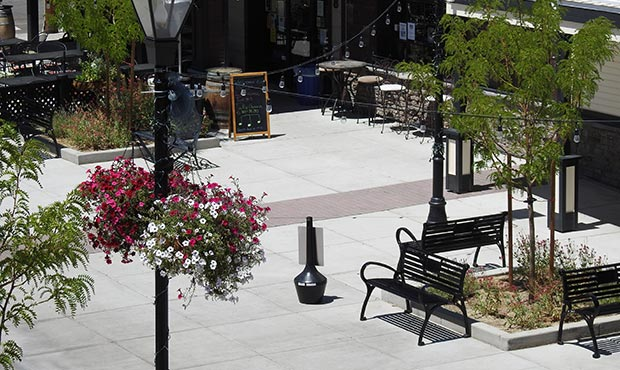 Schenley benches arranged for outdoor seating in a pedestrian zone