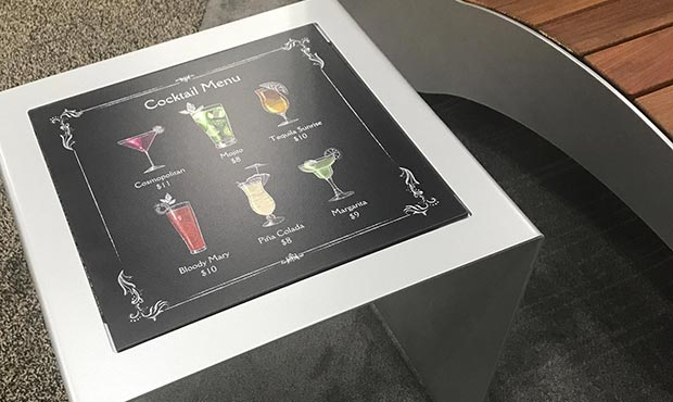 Custom drink menu on an interchangeable table surface