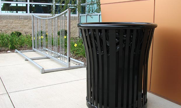 Steel litter receptacle and bike rack outside a health center
