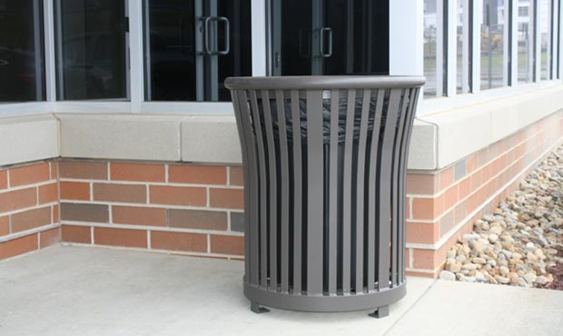Harmony Litter Receptacle set against brick background