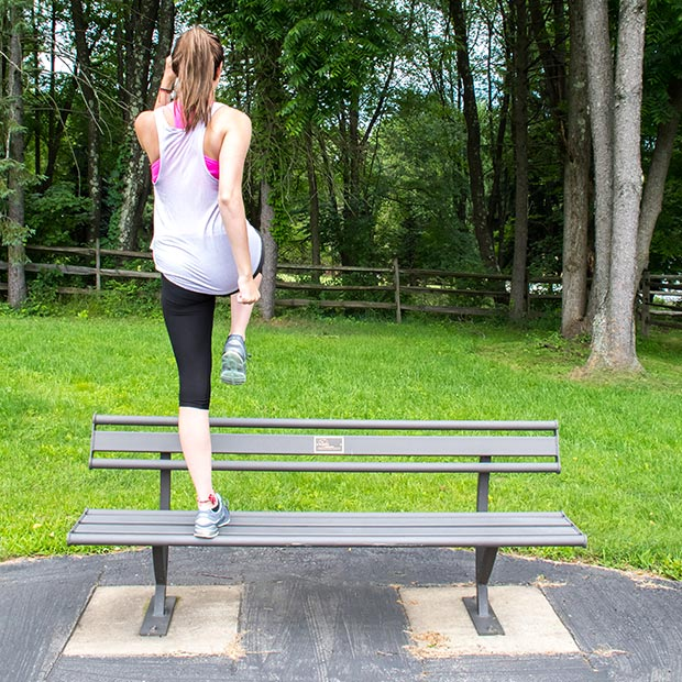 Step Up With Knee Drive Exercise on a Penn Bench