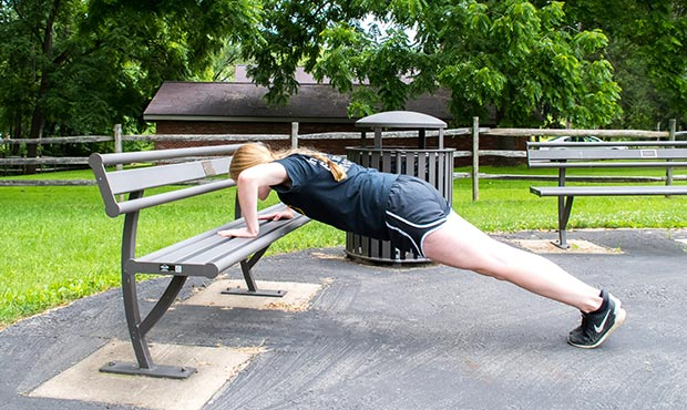 Pushup exercuse on a Penn Bench