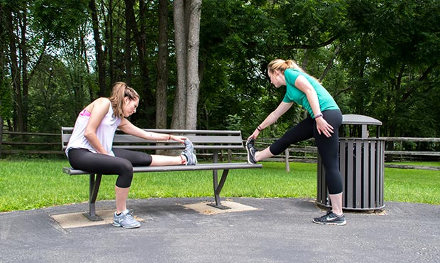 Stretching before exercising on a Penn Bench