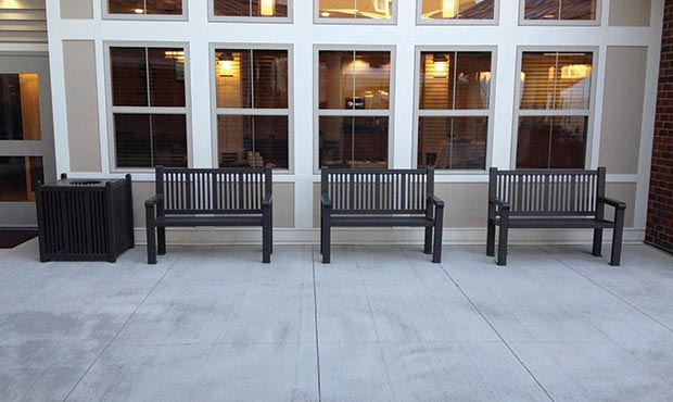 Reading benches and receptacle at senior living center