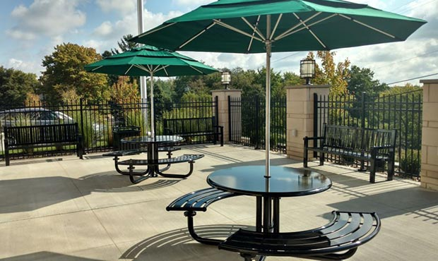 Penn Table Sets with umbrellas on a corporate patio