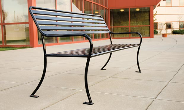 The Sienna bench graces a cultural center with its airy presence