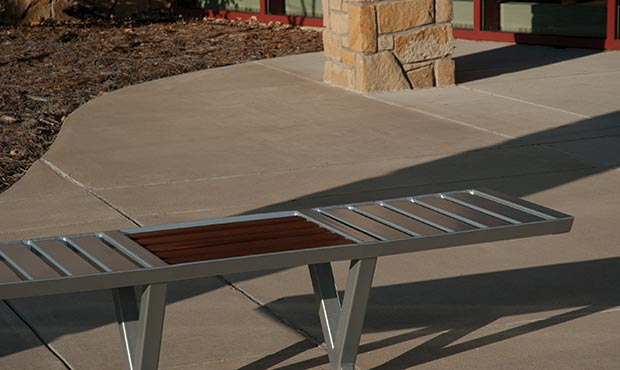 Volant Flat Bench situated outside a corporate campus