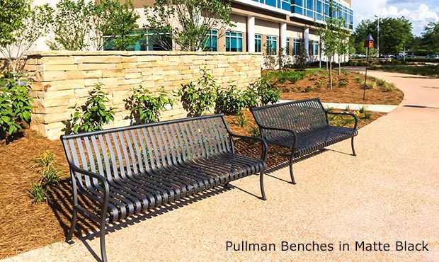 Pullman Benches with Back in Matte Black outside a healthcare facility