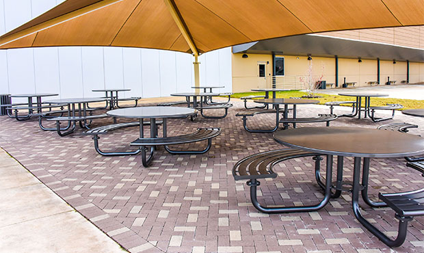 Penn Table Sets situated under a canopy outside