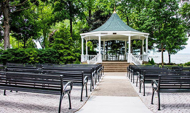 Rows of Schenley Benches face the pavilion stage