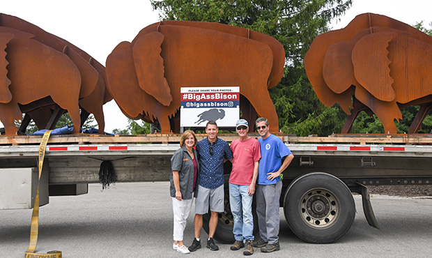 Family In Front of Metal Bisons