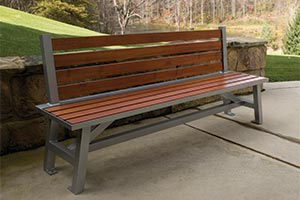 Wood Grain Aluminum Slats on Breakwater Bench with Back in front of stone wall