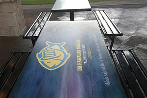 Branded Logo Artwork on Custom Restaurant Tables