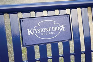 Decal of Keystone Ridge Designs' logo on bench back