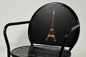 Eiffel Tower artwork on the back of an Olivia Chair