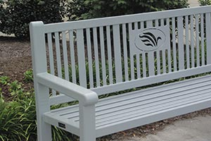 Silver Reading bench with laser cut logo