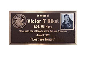 Memorial plaque with portrait photo
