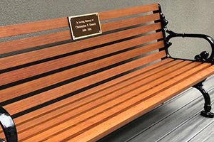 Wood Grain Aluminum Slats on Rosedale Bench with Back and cast bronze plaque