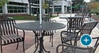 Courtyard Table and Chair Sets with umbrellas on an outdoor patio