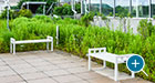 This rooftop green space includes a pair of flat Liberty benches