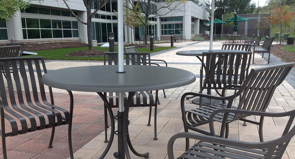 Courtyard Table Set and Exeter Benches with Back on a corporate campus