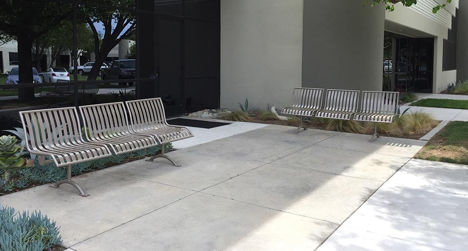 Pullenium Benches with Back flank the entrance to an office building