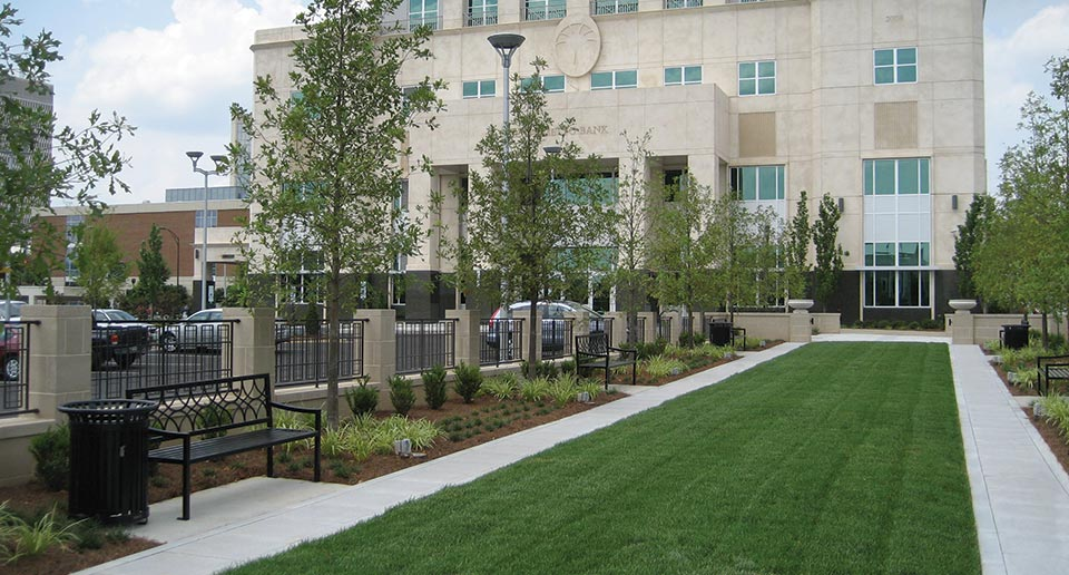 Kilian Benches and Midtown Litter Receptacles outside a local bank building