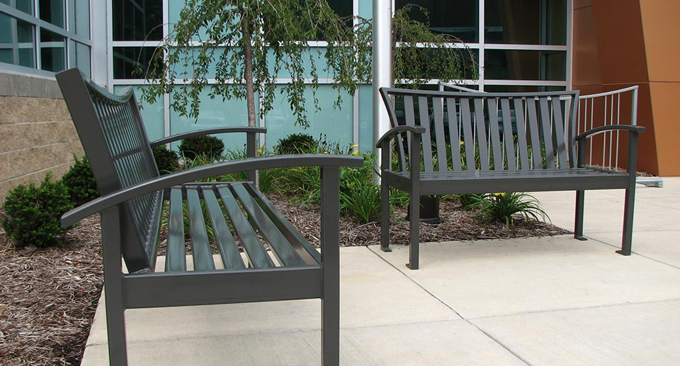 Exeter Site Furniture products sit by the entrance to a YMCA