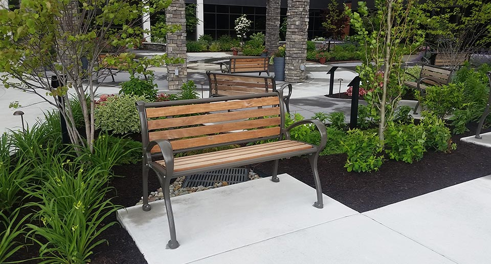 Schenley Benches with Back and wooden slats provide seating for an office park
