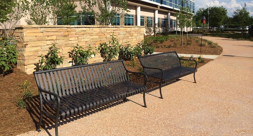 Pullman Benches with Back at the entrance to an office building