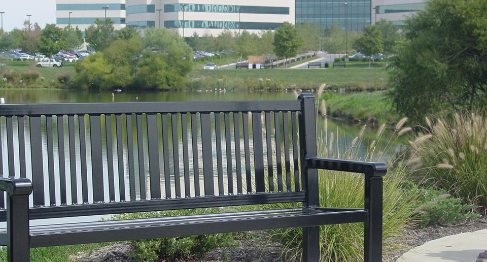 Reading Bench with Back installed on a walking track near an office park