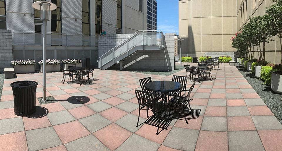 Courtyard Table Sets and Harmony Litter Receptacles provide outdoor eating options