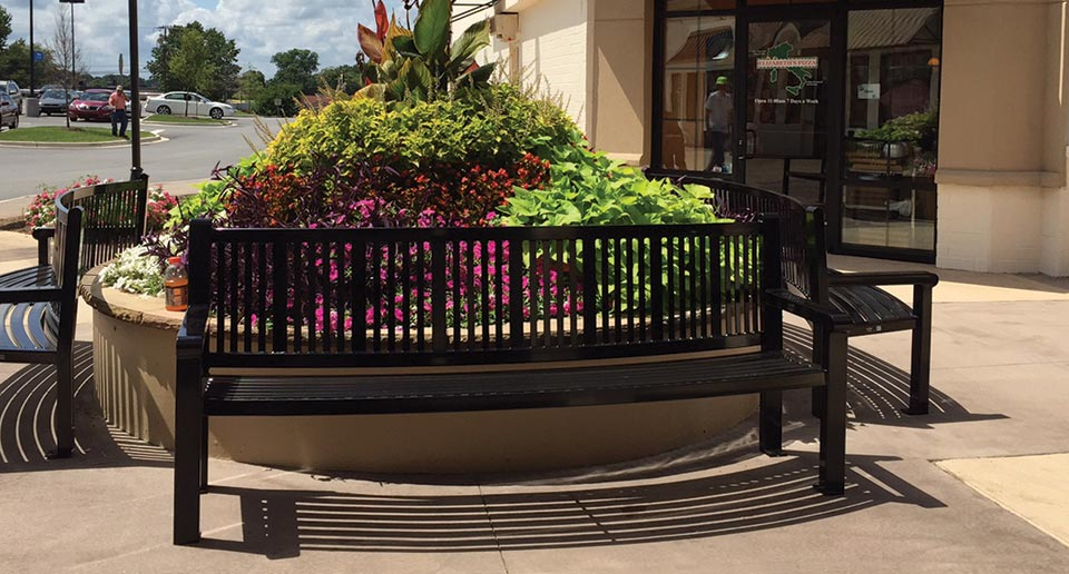 Custom Curved Reading Bench with Back at an outdoor shopping mall