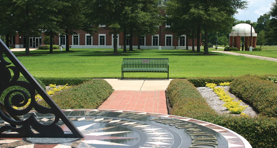 Pullman Bench with Back and Plaque in a college campus setting