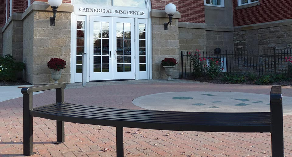 Curved Flat Reading Bench outside of an Alumni Building