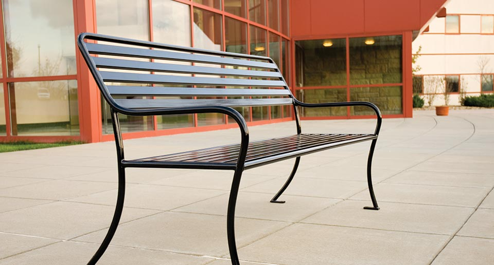 Sienna Bench with Back outside a school building