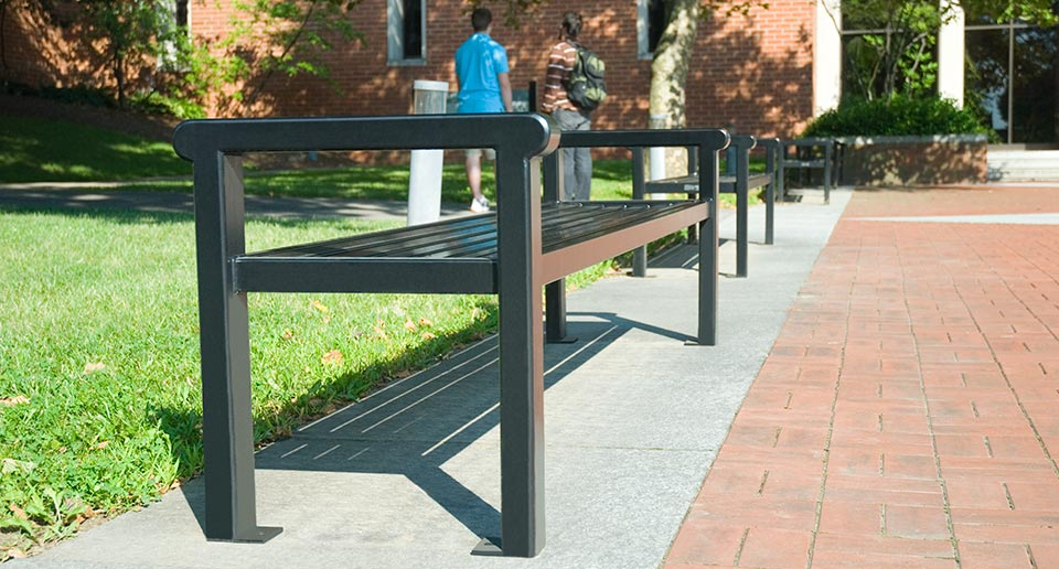 Flat Reading Benches at a school with students in the background