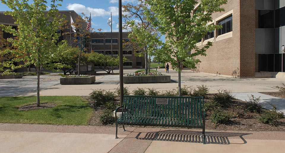 Pullman Bench with Back and Plaque installed on a University campus