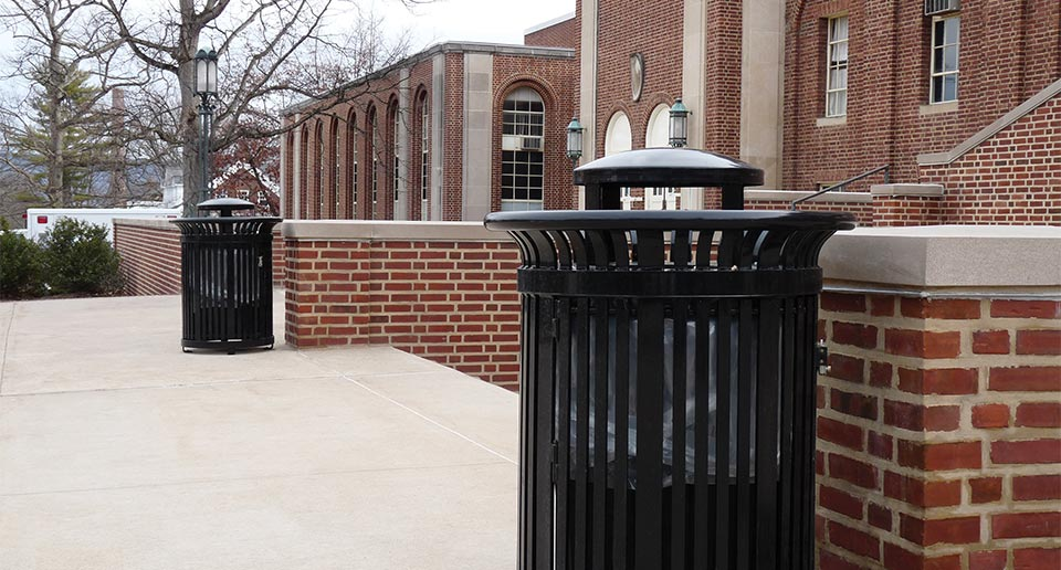 Midtown Litter Receptacles outside the entrance to a school gymnasium