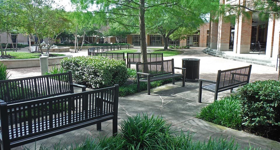 Reading Benches and Litter Receptacles in a college courtyard environment