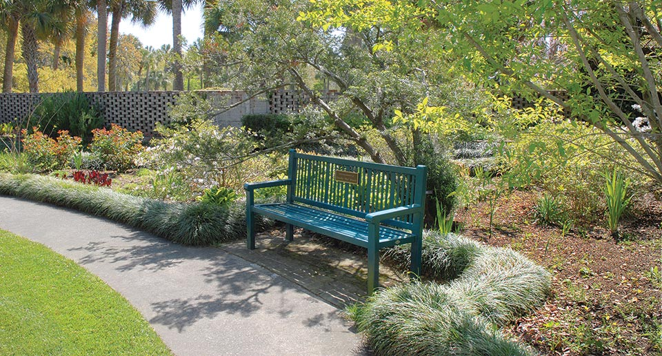 Reading Bench with Back and plaque installed in a botanical garden