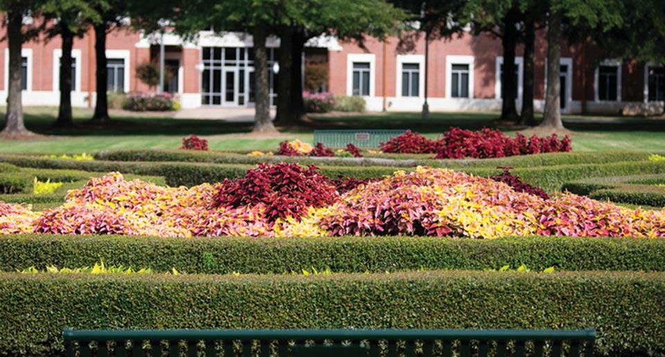 Pullman Benches in a beautiful garden setting on campus