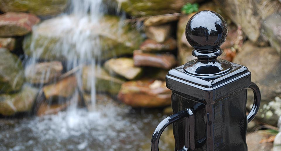Bellevue Bollard set against a water feature backdrop