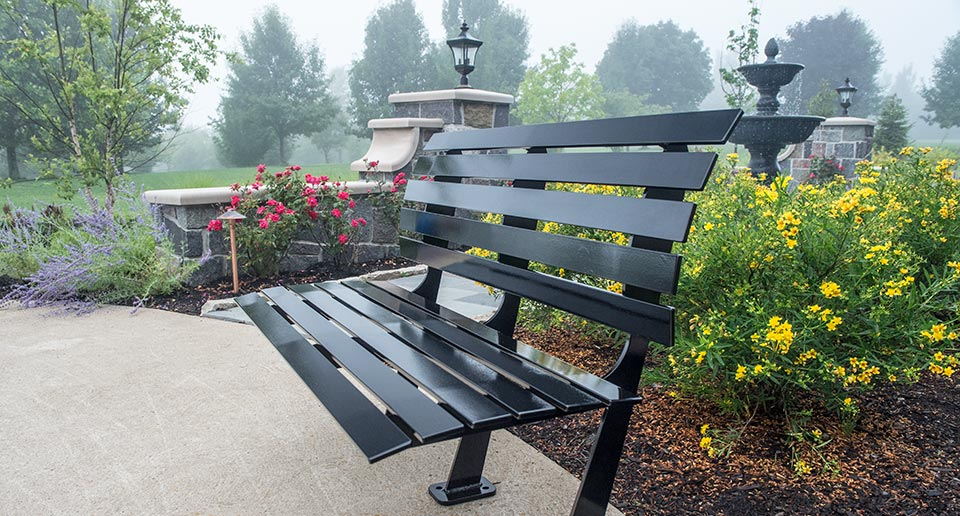 Carson Bench with Back in an outdoor residential garden patio