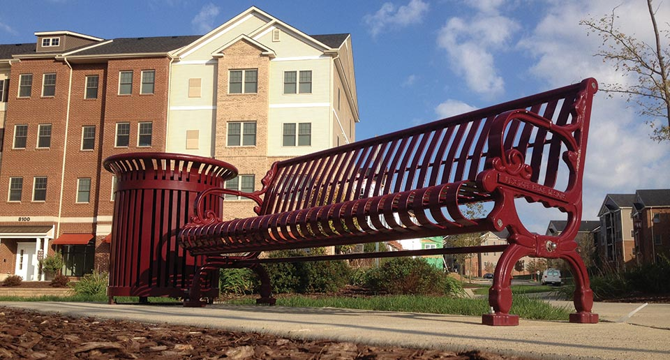 Lamplighter Bench with Back and Midtown Litter outside of a new mixed-use housing complex