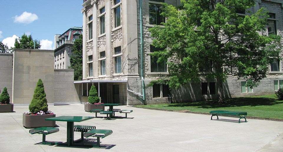 Hapsburg Table Sets and Flat Lamplighter Bench outside of a county administration building