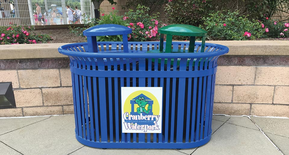 Midtown Dual Receptacle with custom KeyshieldArt branding outside a public swimming pool
