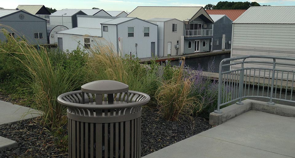 Midtown Litter Receptacle installed on an outdoor community patio